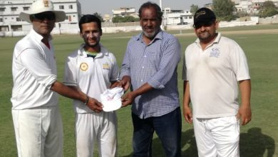 Secretary Larosh CC Muhammad Nizam gives away the official cap of LCC to Wahid Khan at TMC Ground here on Friday. Captain LCC Saeed Ali and Ex frist calss cricketer Kamran Hussain also seen.