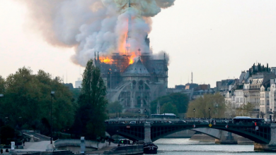 Smokes and flames rise from the landmark Notre Dame Cathedral in central Paris Notre Dame